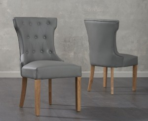Ariel Dining Chairs In Grey Faux Leather And Oak Legs In A Pair