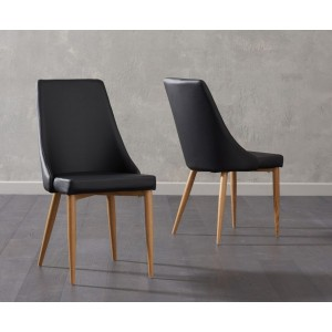 Terrance Dining Chair In Black Faux Leather And Oak Legs In A Pair