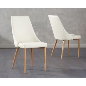 Terrance Dining Chair In Cream Faux Leather And Oak Legs In A Pair