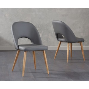 Payton Dining Chair In Grey Faux Leather And Oak Legs In A Pair